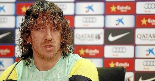 Carles Puyol, durante la rueda de prensa tras el entrenamiento de hoy.