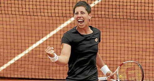 Carla Suárez celebra la victoria ante la croata Tomljanovic.