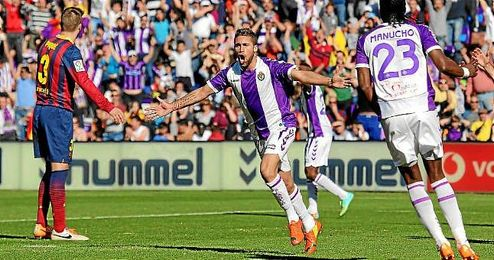 Fausto Rossi celebra un gol conseguido ante el Barcelona.