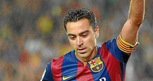 Xavi celebra un gol con el Barça.