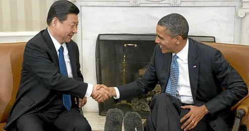 Barack Obama reunido con Xi Jinping.