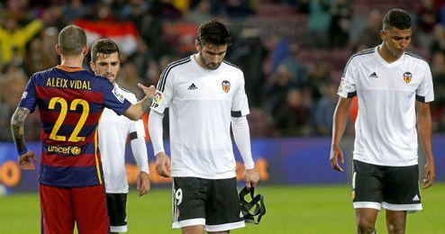 Los jugadores del Valencia acabaron hundidos el mi�rcoles.