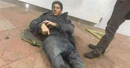 Bellin, herido y sangrando en el suelo del aeropuerto belga.