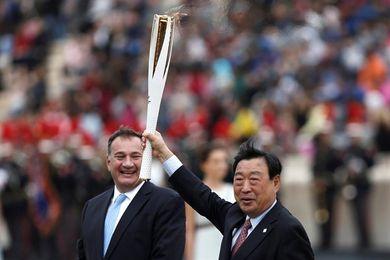 Atenas despide la llama olímpica, que pone rumbo a Corea