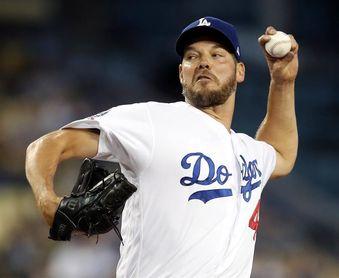 7-2. Hill afianza a los Dodgers en el liderato