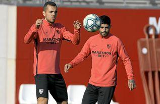 Jordán, en un entrenamiento junto a Banega.