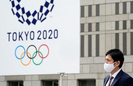 Suga señala que la decisión final sobre los JJOO no corresponde solo a Japón